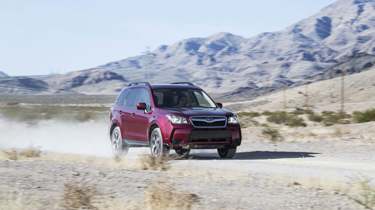 2014-Subaru-Forester-20XT-front-three-quarters-in-motion.jpg